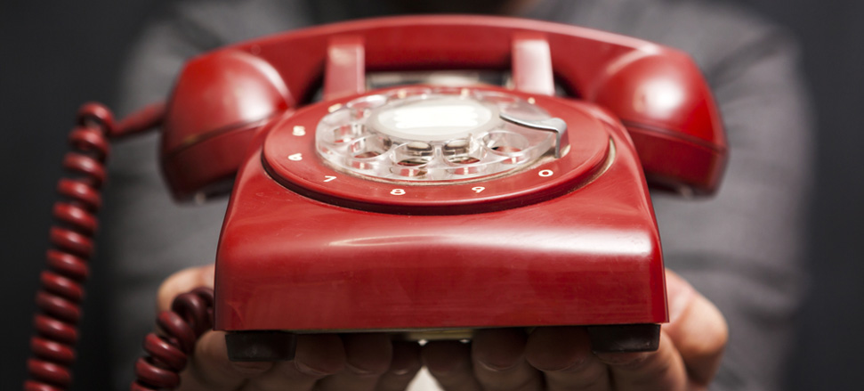Close up photo of a red telephone